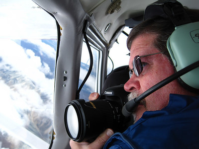 Unknown to me, until we returned from our Alaskan adventure, my wife captured this moment of me doing what I love.  The photographer seldom gets in the picture.  I was obviously in deep thought and focused at 14,000 feet.  Thank you Lynda, I love you, Ron